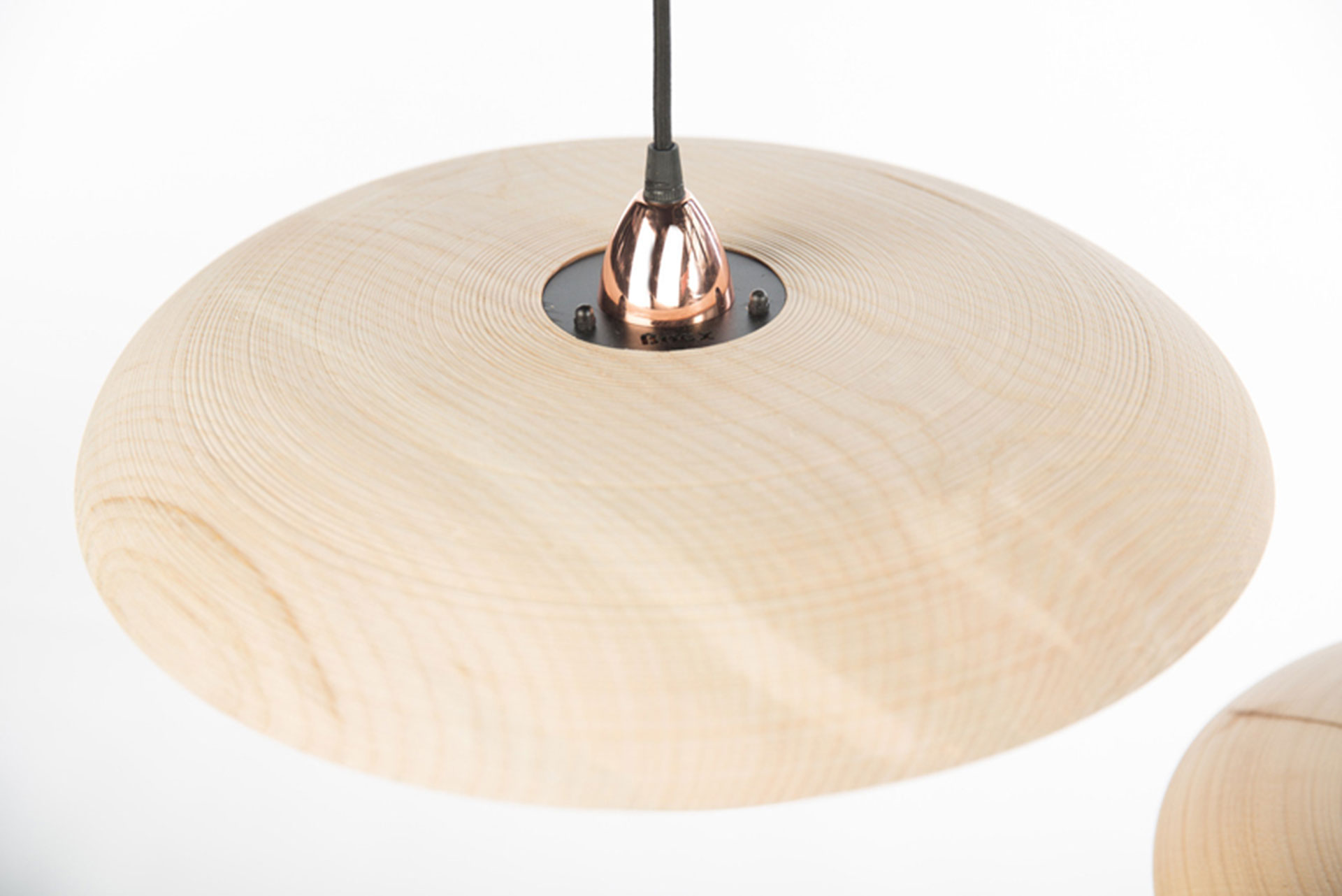 Detail showing copper pendant fixture of hand turned timber light