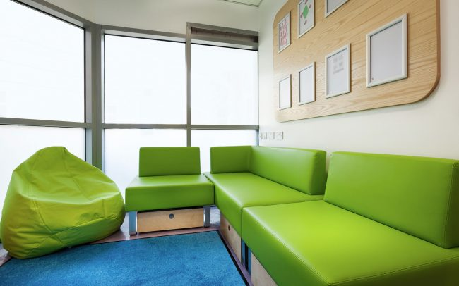 Infection compliant upholstery in teenage day room designed by Boex