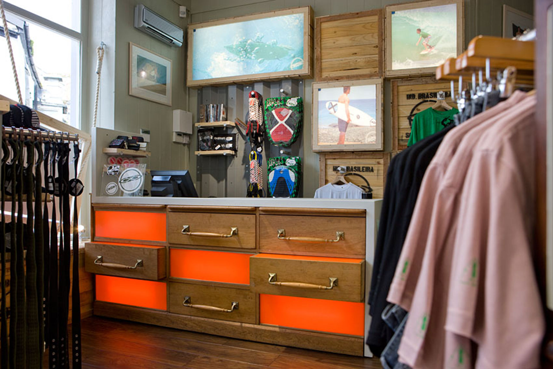 Timber feature display boxes and surf imagery at South to South shop