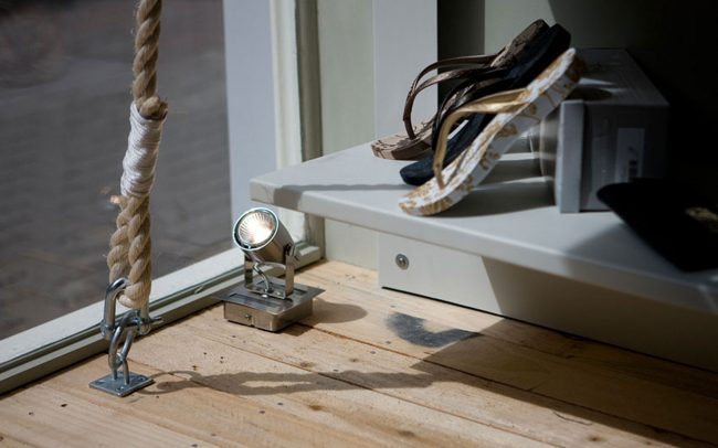 Rope detailing attached to timber floor for redesign of South to South