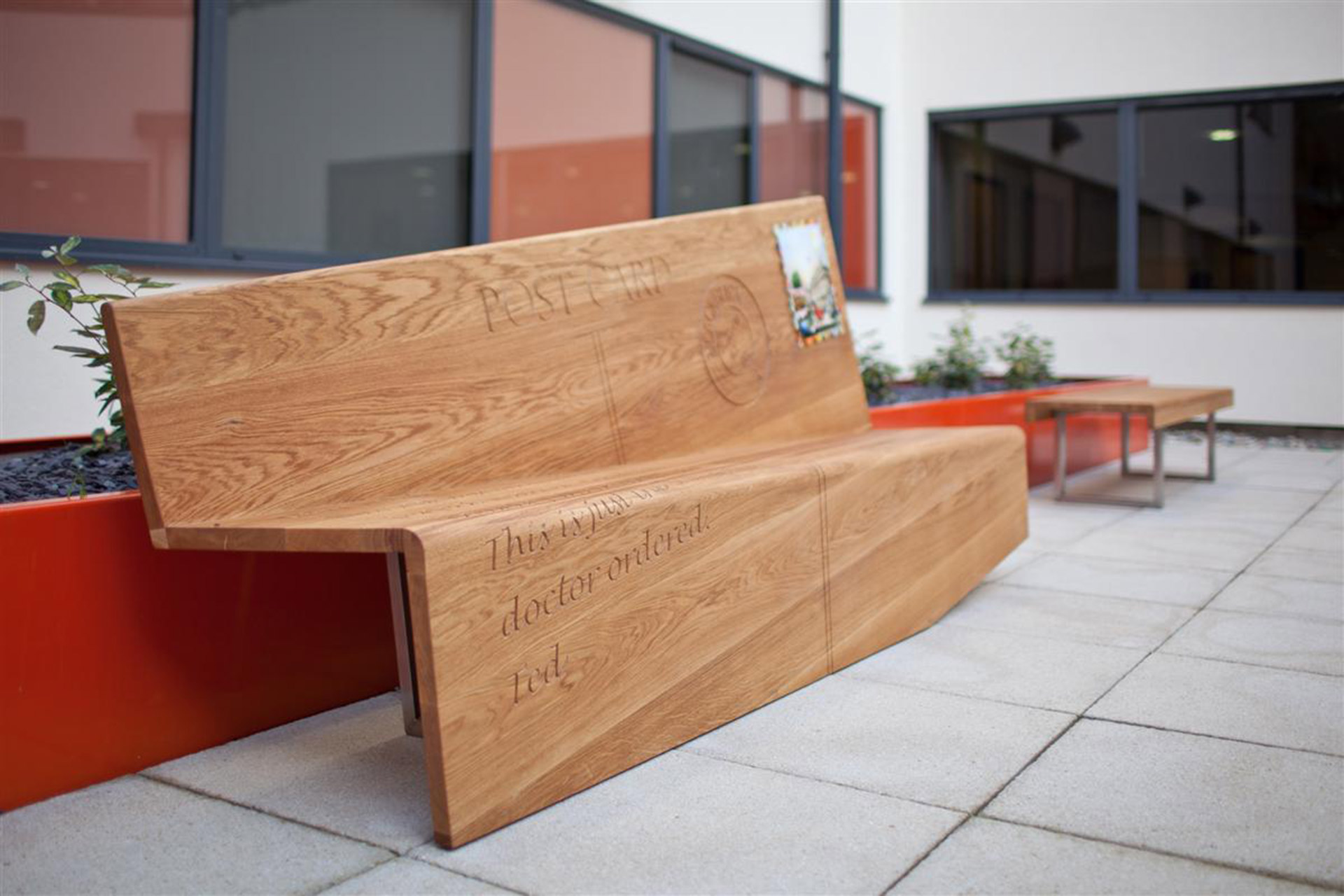 Boex designed rolled oak top bench in courtyard at Barbara Castle Way Health Centre