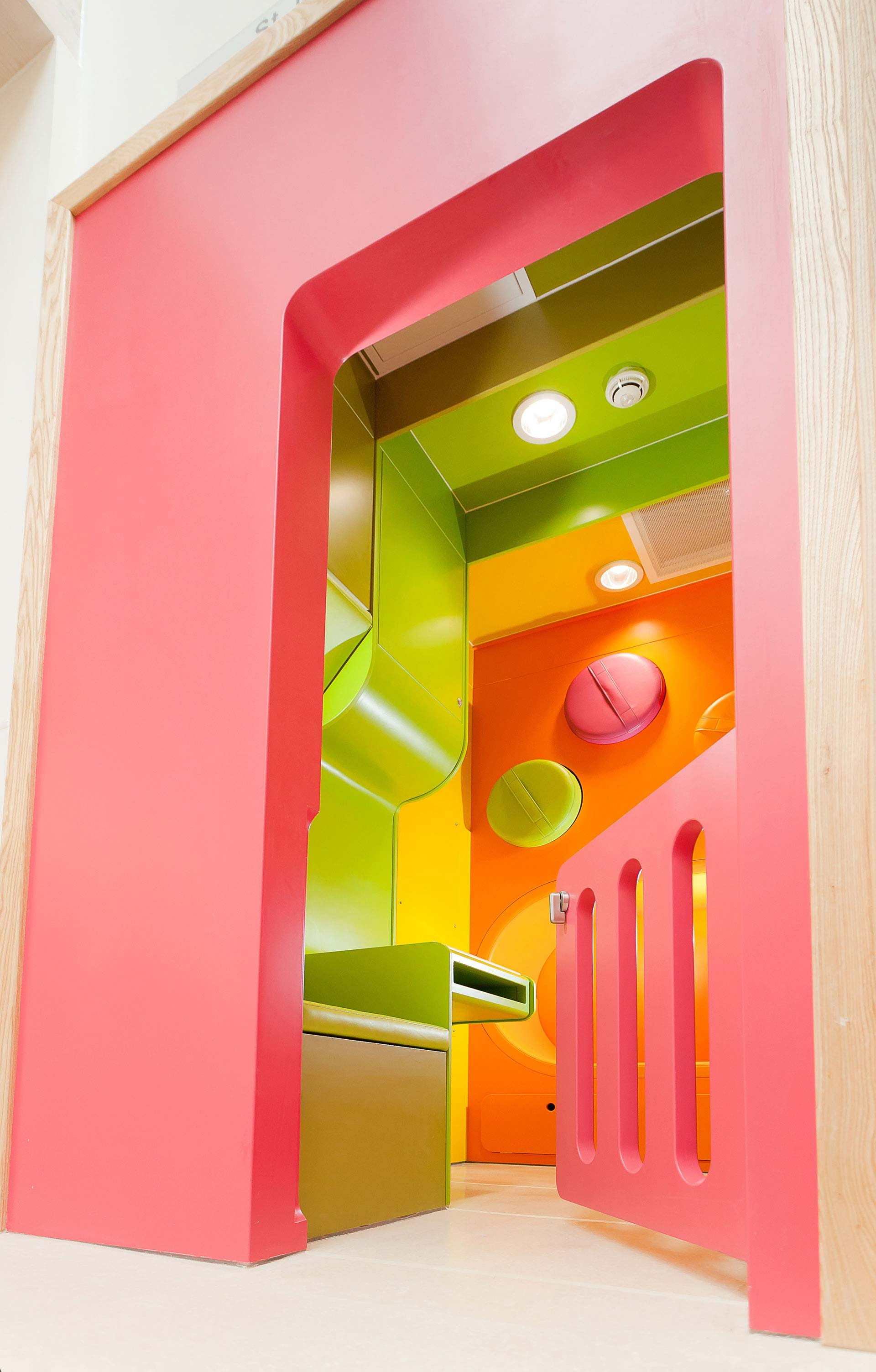 Child safety gate at entrance to neonatal play room
