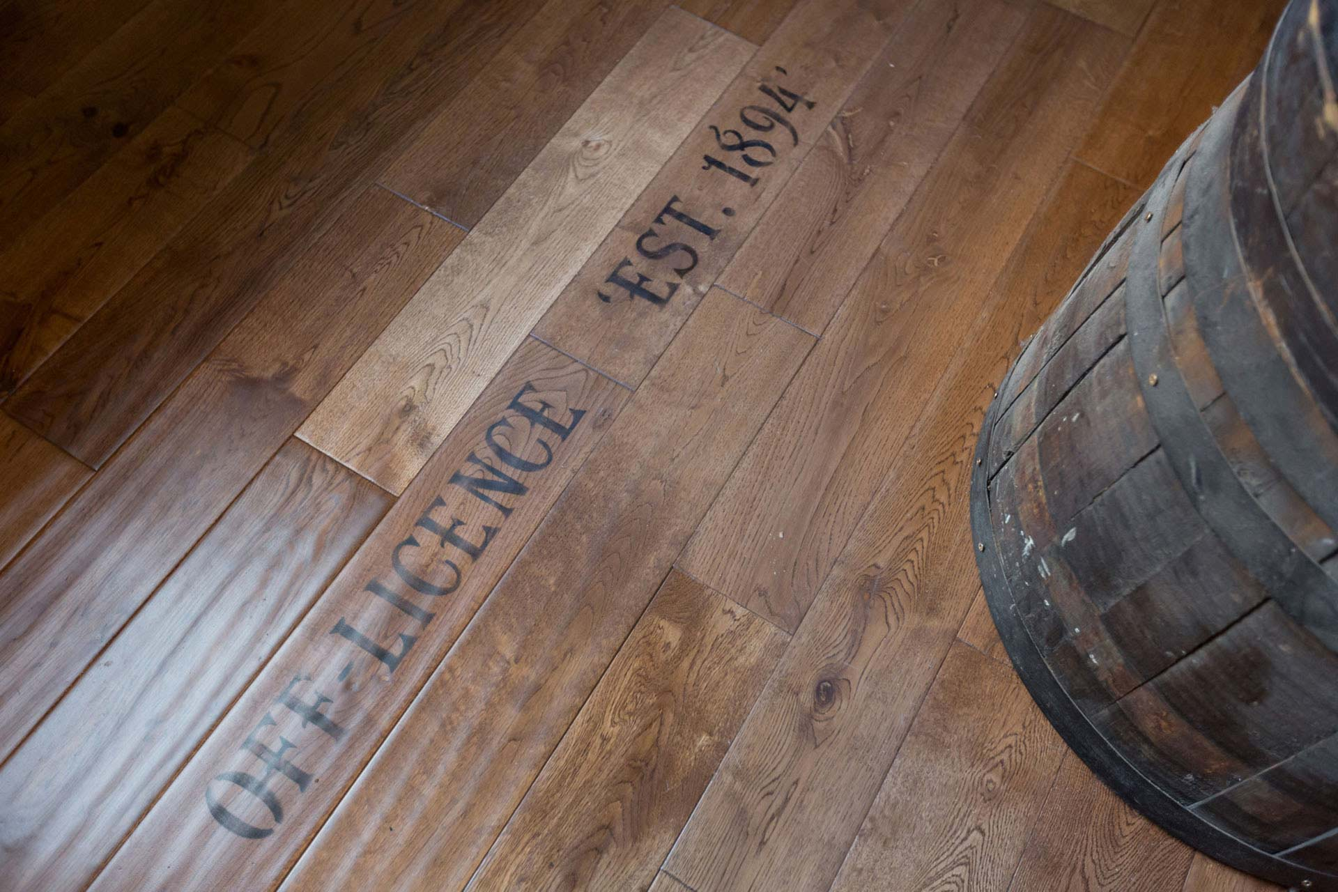 Oak flooring with stencil detail, highlighting interesting facts about the shop