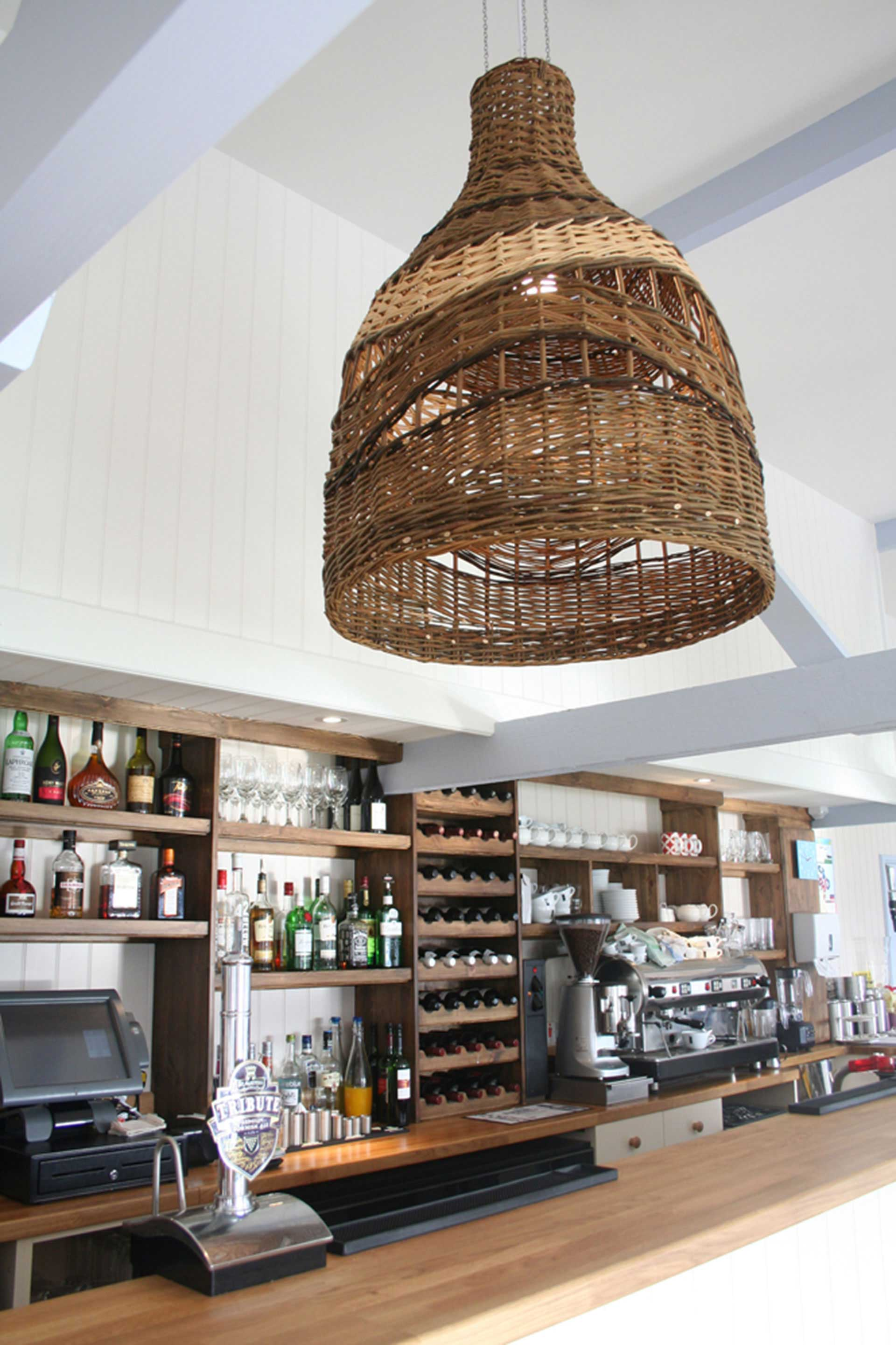 Handcrafted wicker light shade suspended over counter
