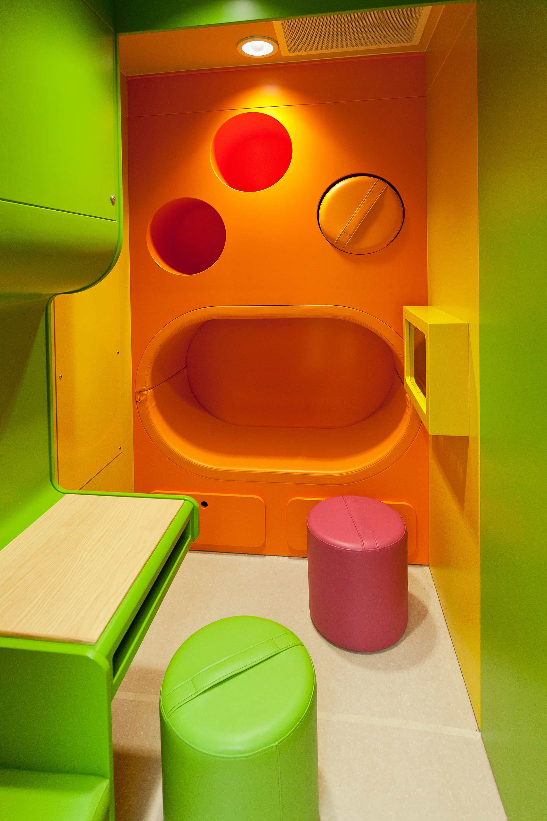 Coloured slices define play and infection control upholstered seating areas