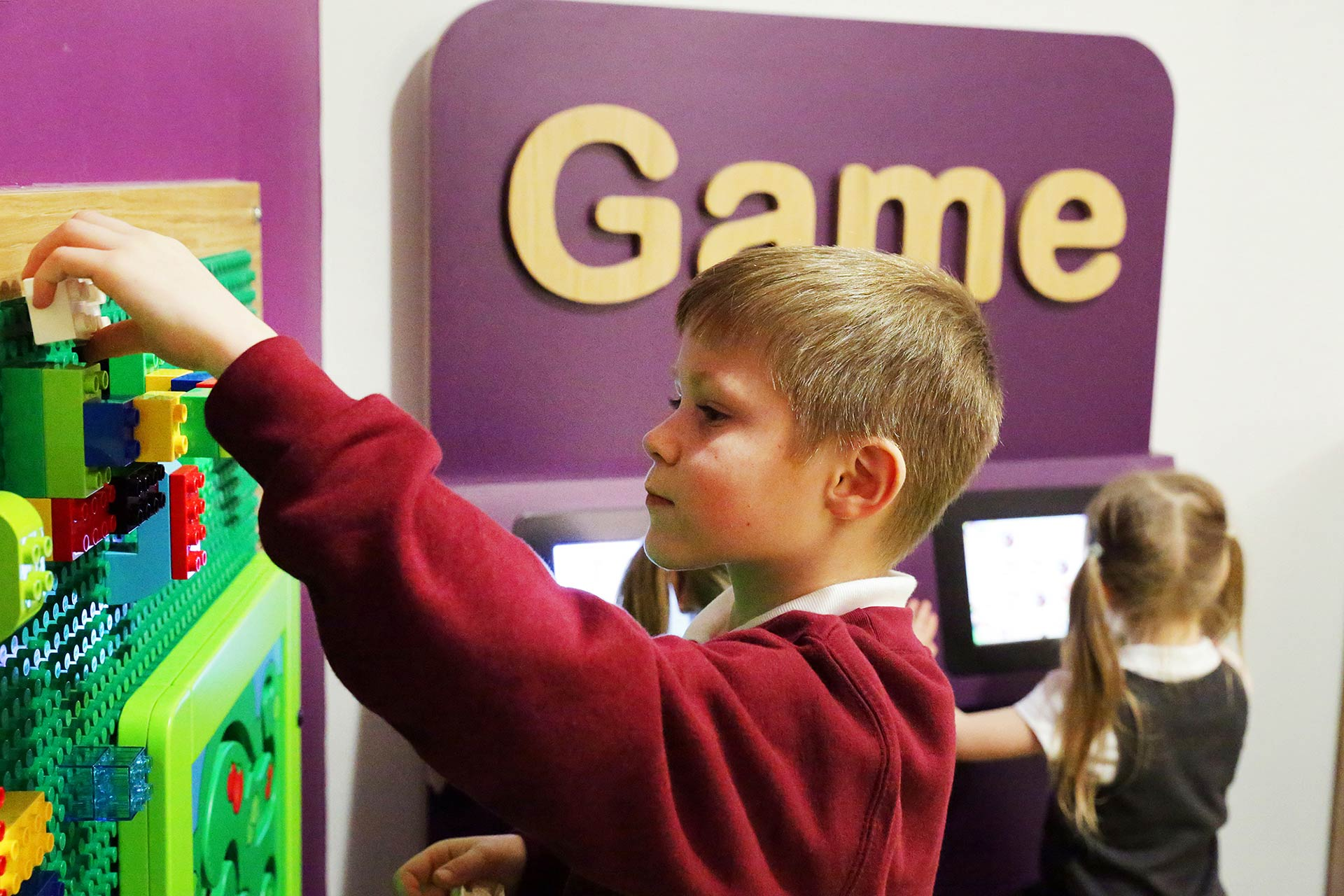 Children playing with interactives at A&E waiting room