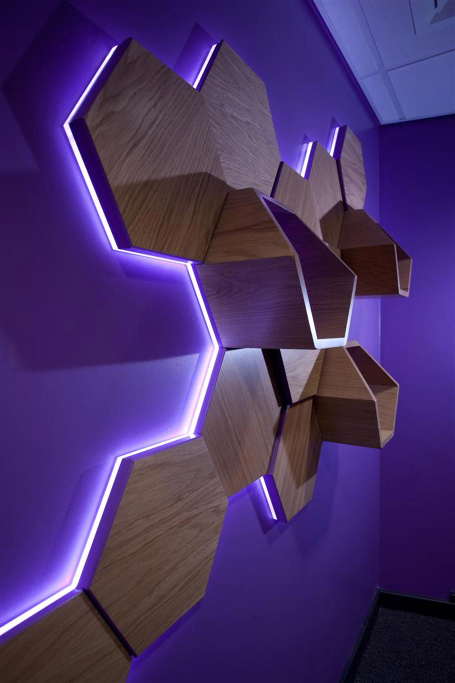 LED back lit timber shelving unit at Young Person's Resource Center