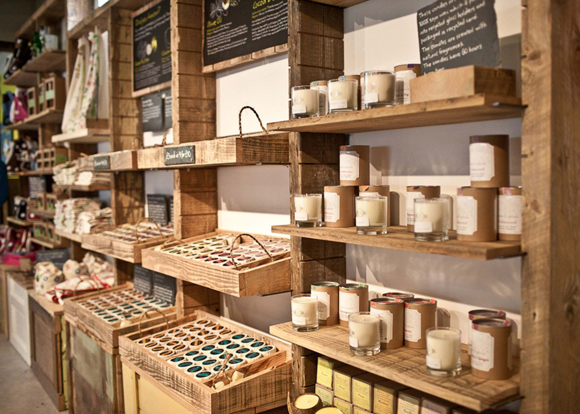Reclaimed timber shelves designed to display merchandise at Eden Project