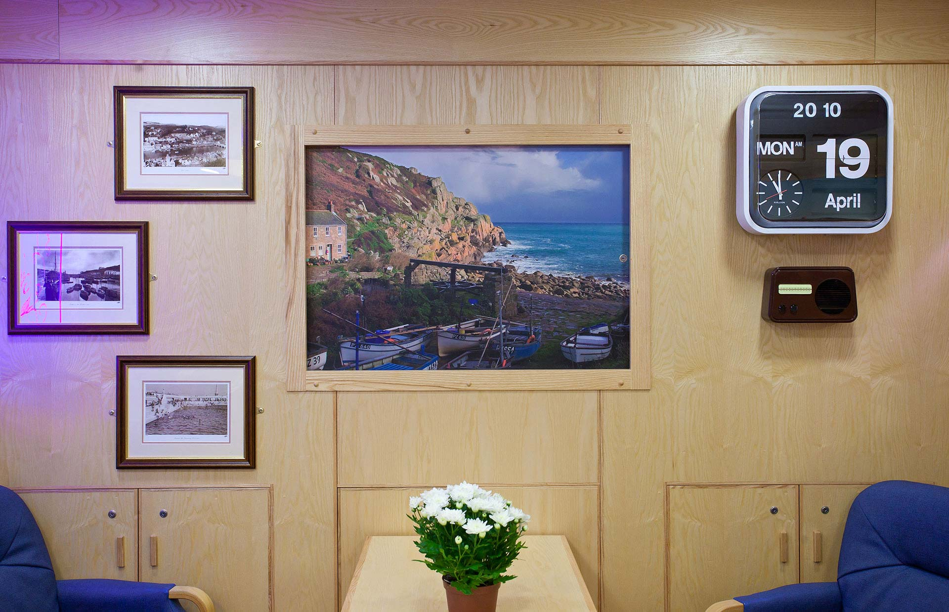 TV screen hidden behind sliding canvas to prevent it becoming a focal point for dementia patients