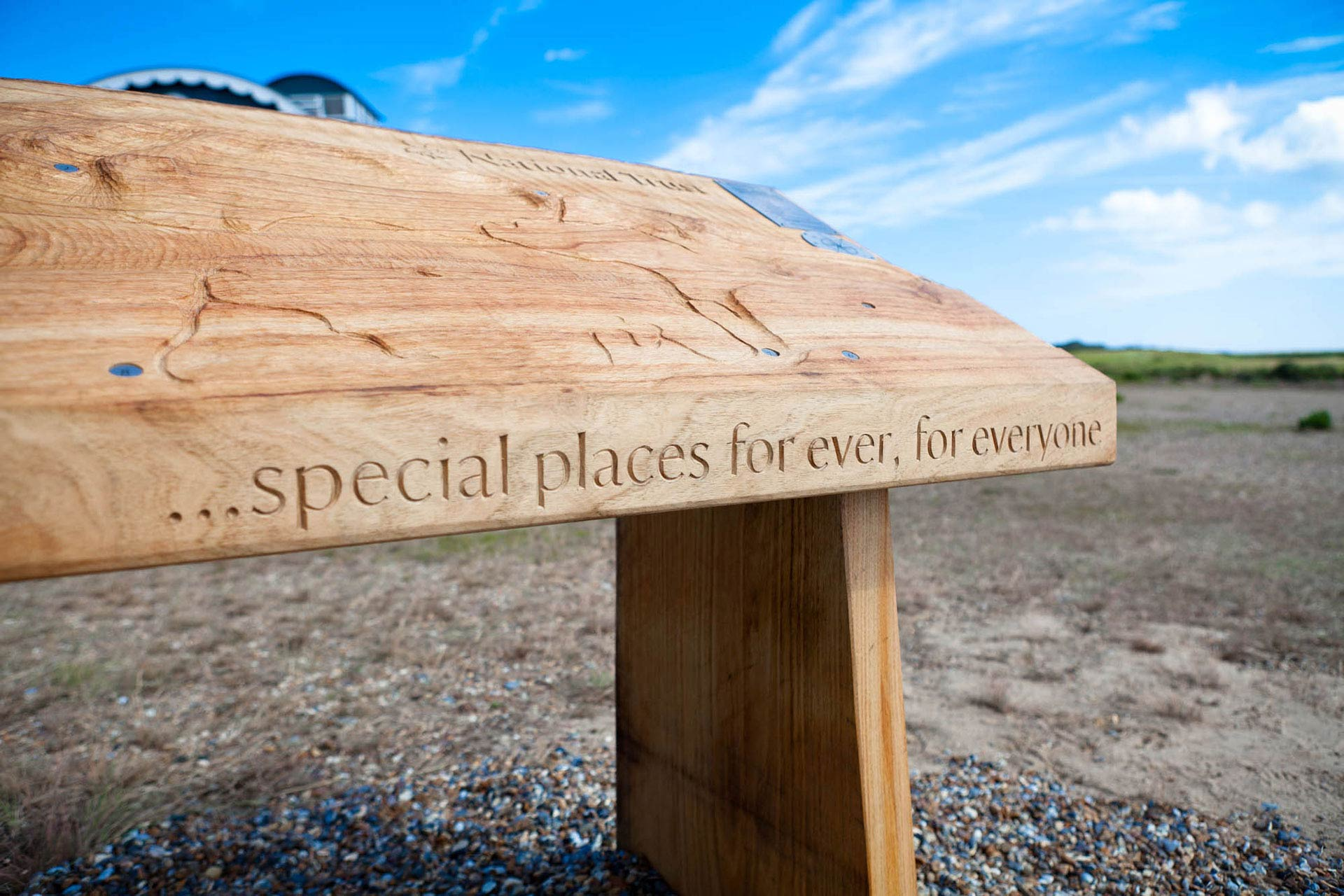 Hand carved typography within wood sign for National Trust