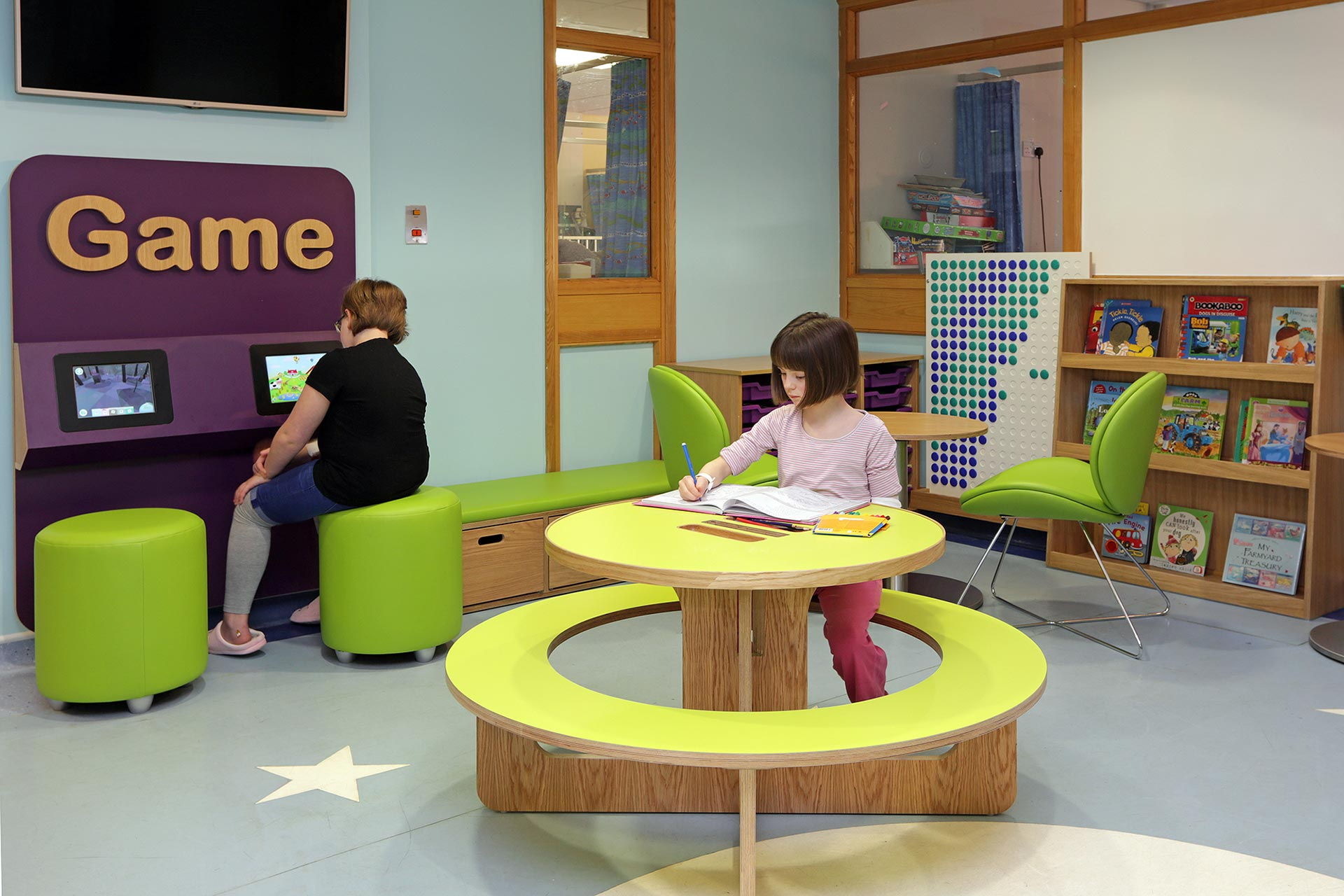 children using bespoke furniture and touch screen interactives