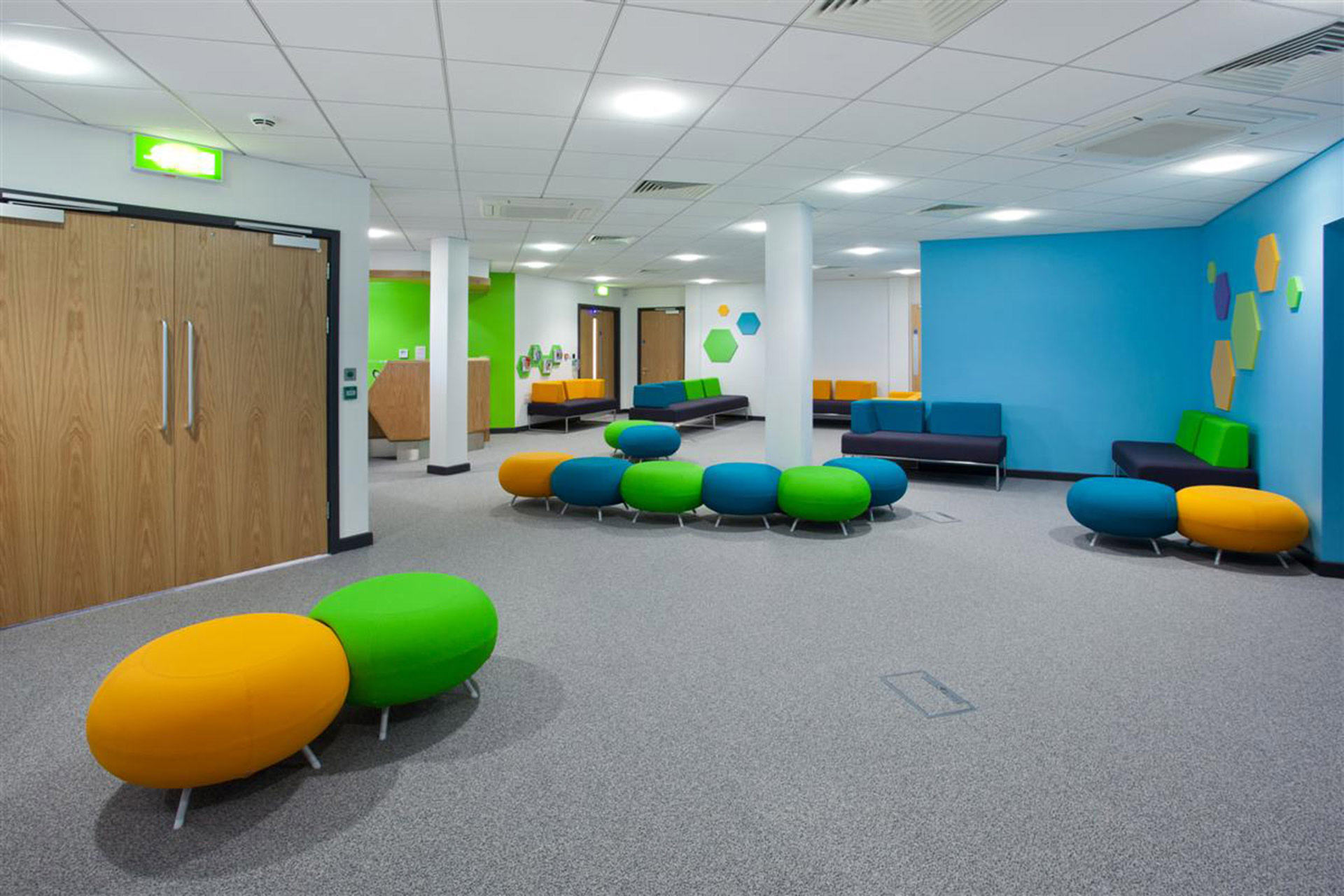 informal seating clusters within NHS waiting area