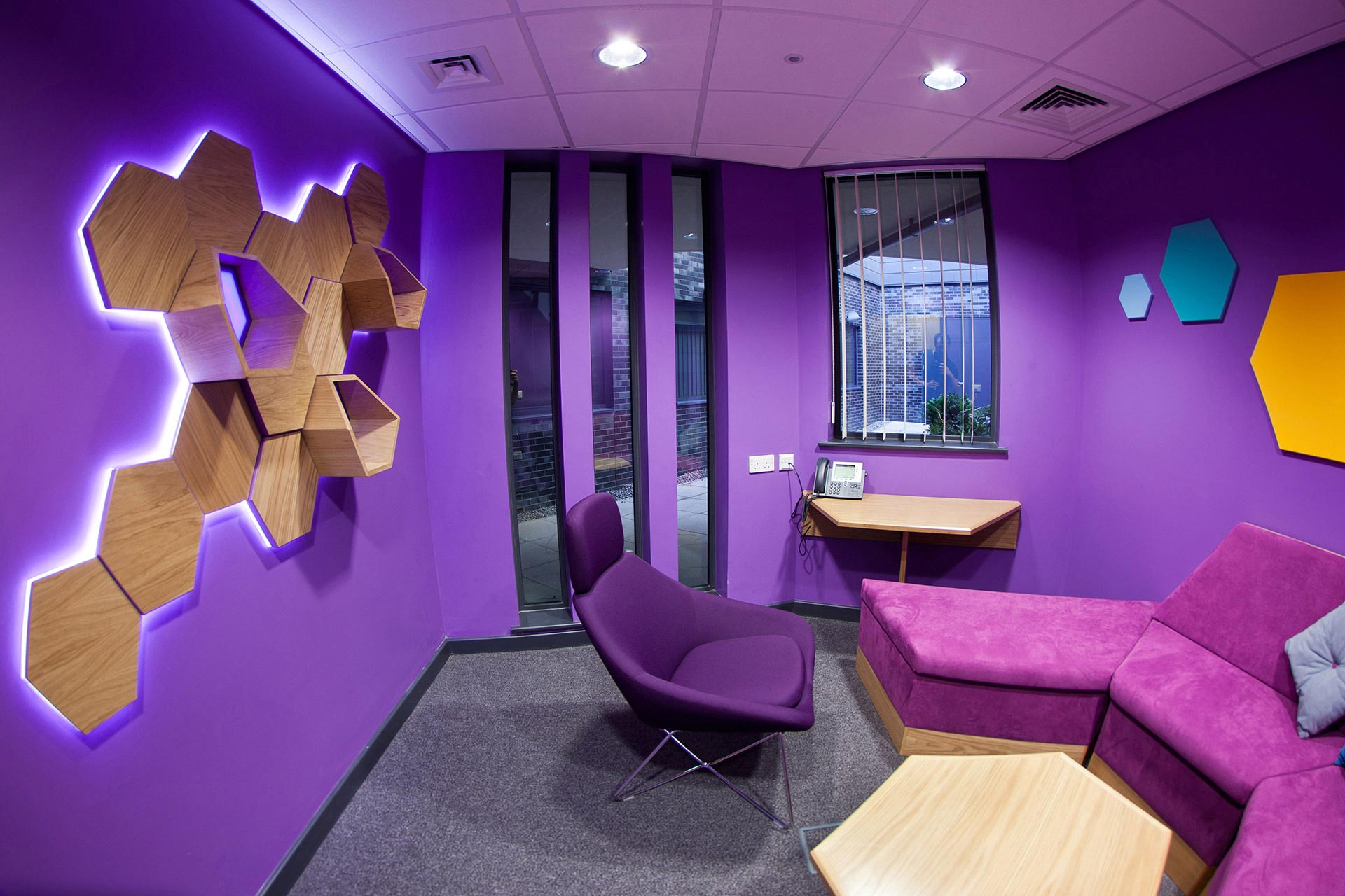 Hexagonal inspired seating in teenagers consultation room