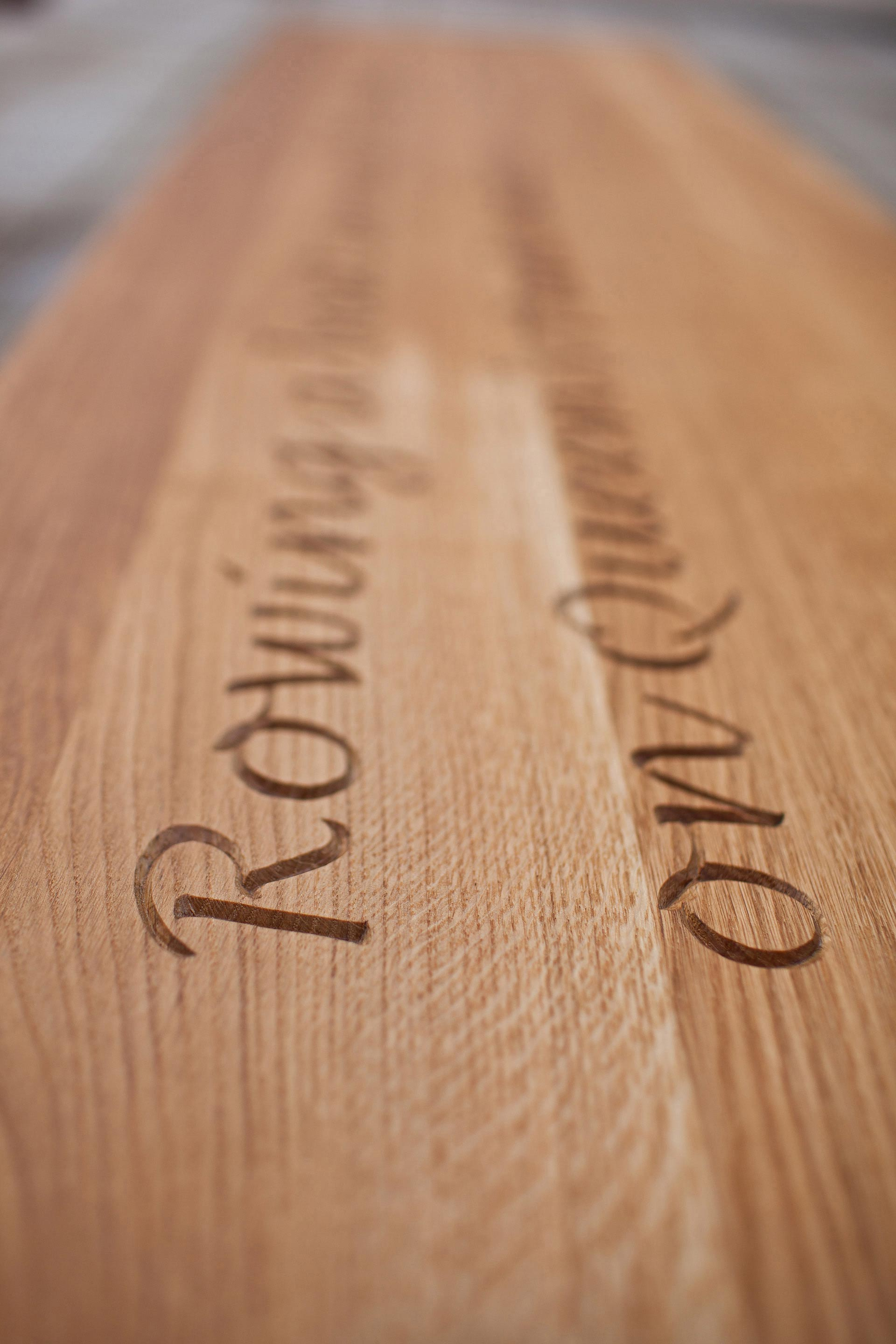 tactile hand carved anecdote on letter bench designed by Boex