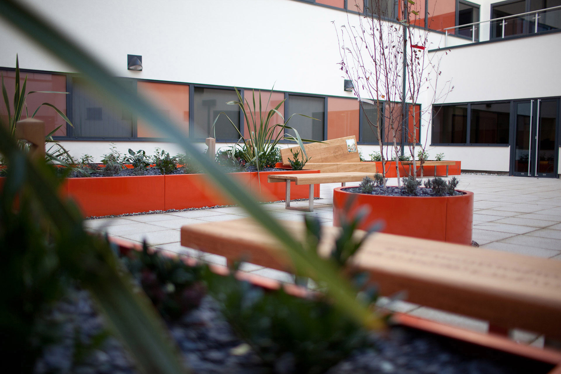 courtyard letter bench seating at Barbara Castle Way Health Centre