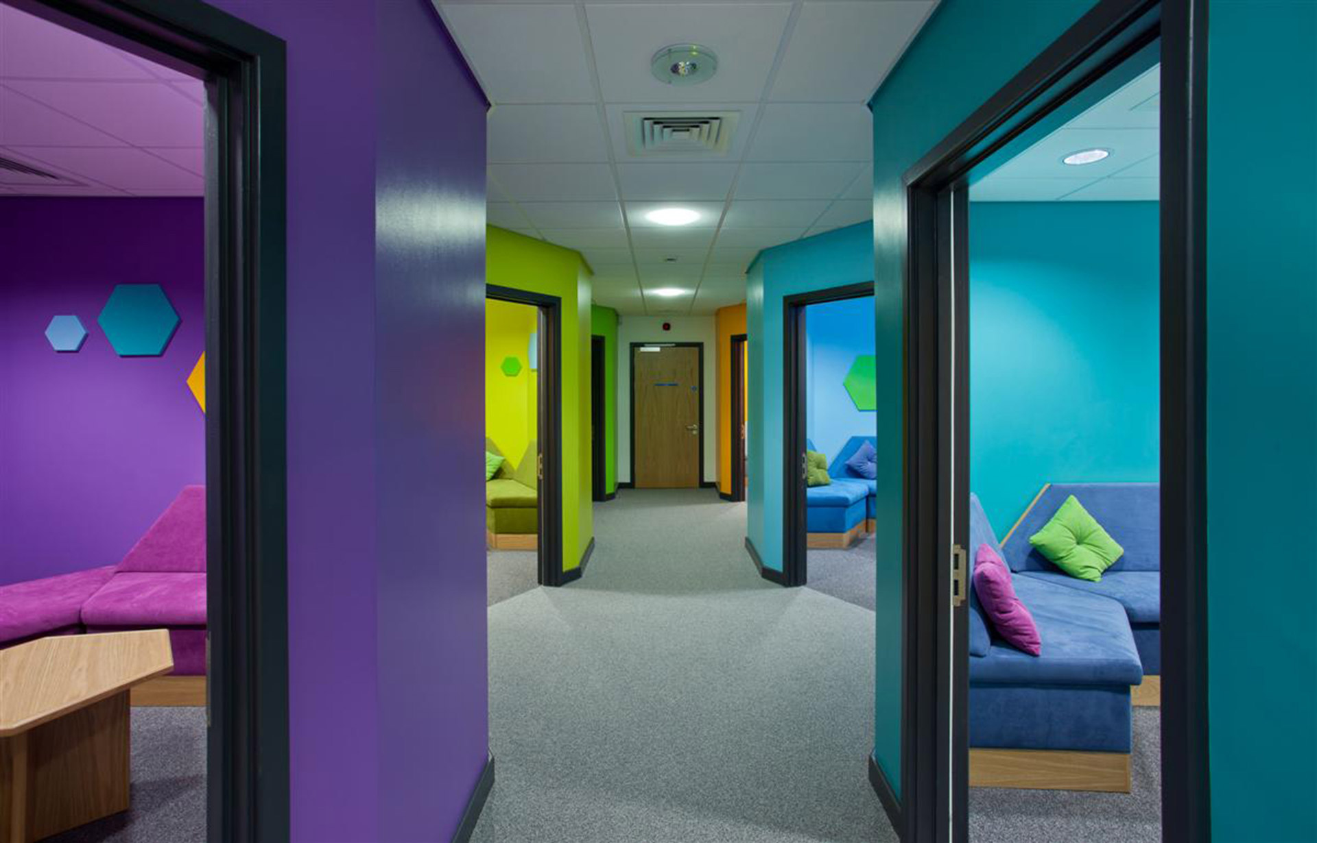 Infection compliant upholstery used in colourful private consultation rooms