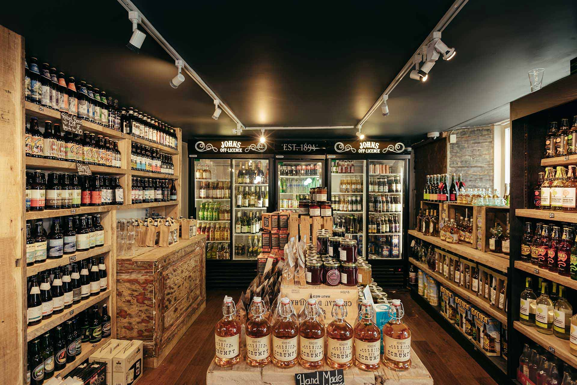 Black ceiling to emphasise merchandise at John's Wine Store