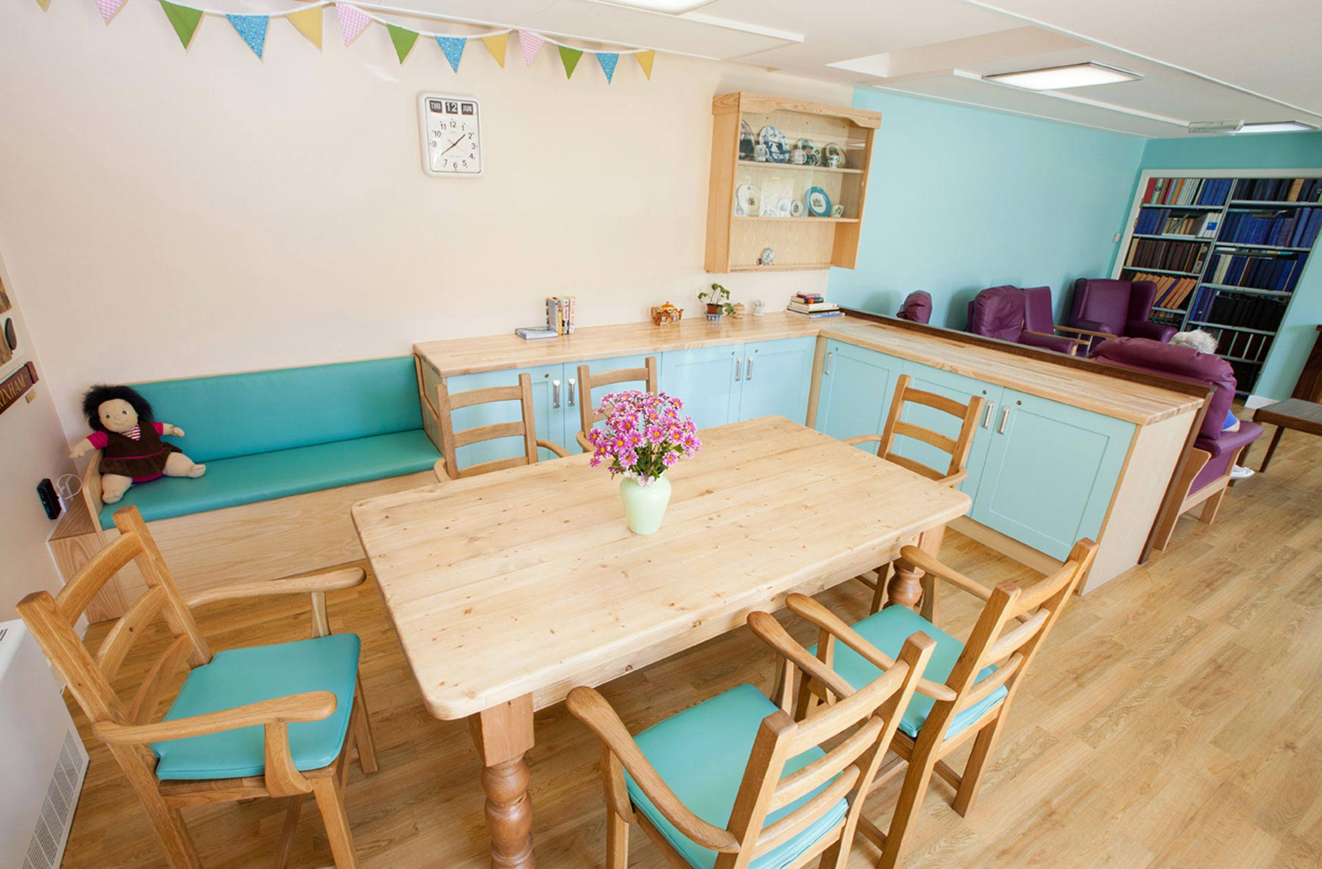 kitchen table provides a domestic living space for dementia ward