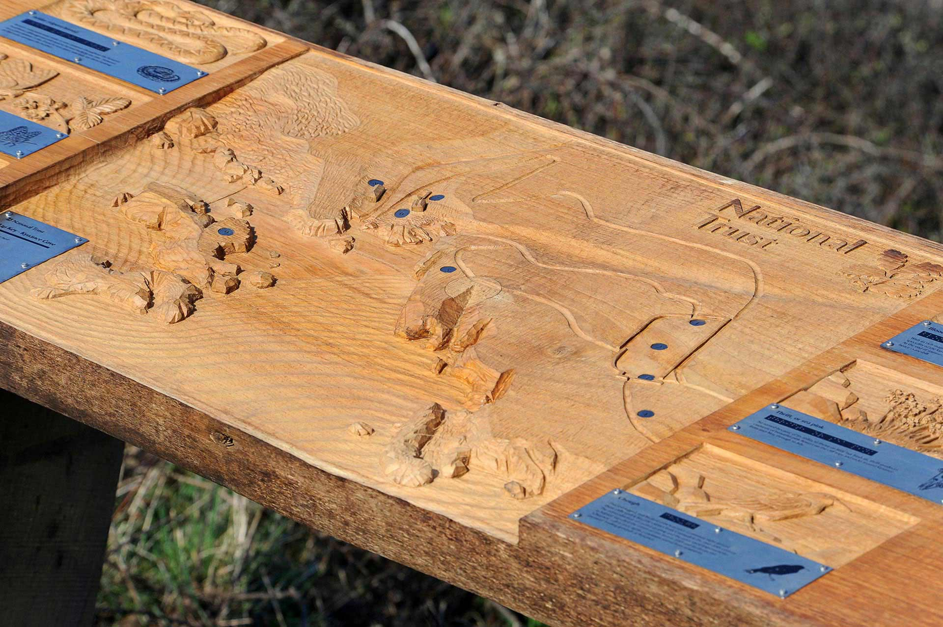 Wood carved sign for National Trust