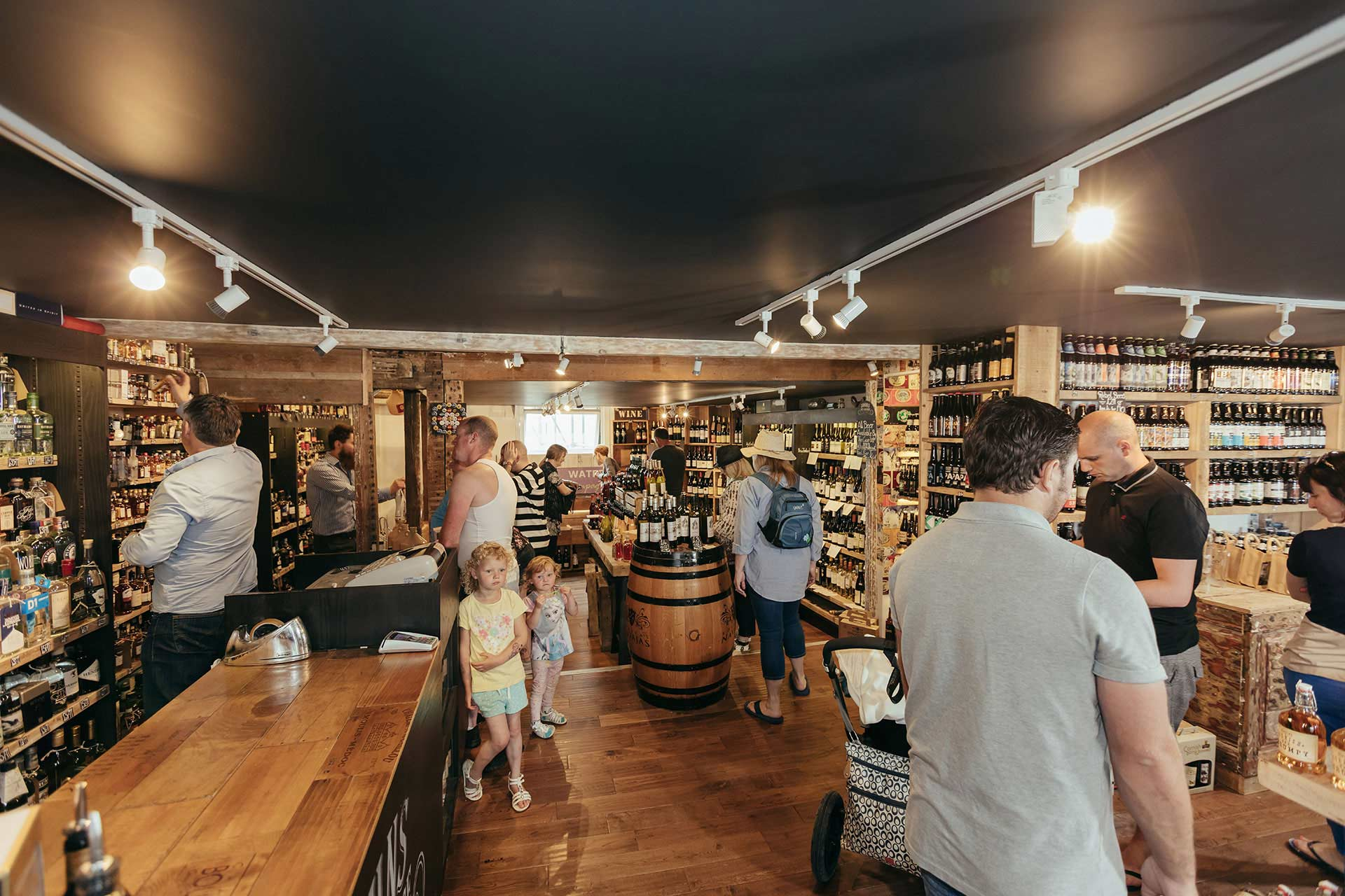 Visitors at John's Wine Store designed by Boex