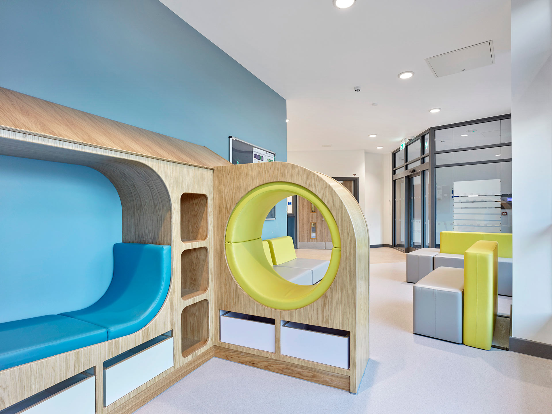 Bespoke playful seating for children waiting in reception at Ancora House