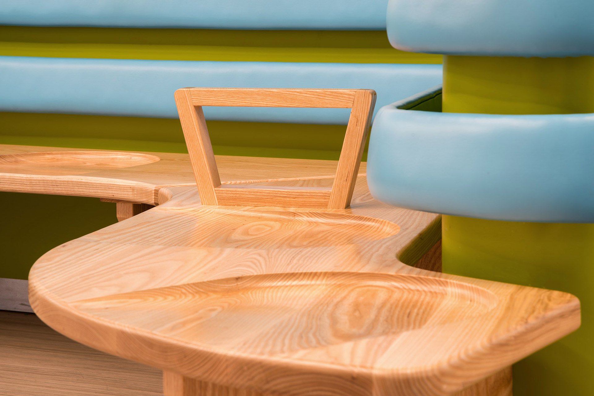 timber seating for patients waiting at chelsea and westminster hospital