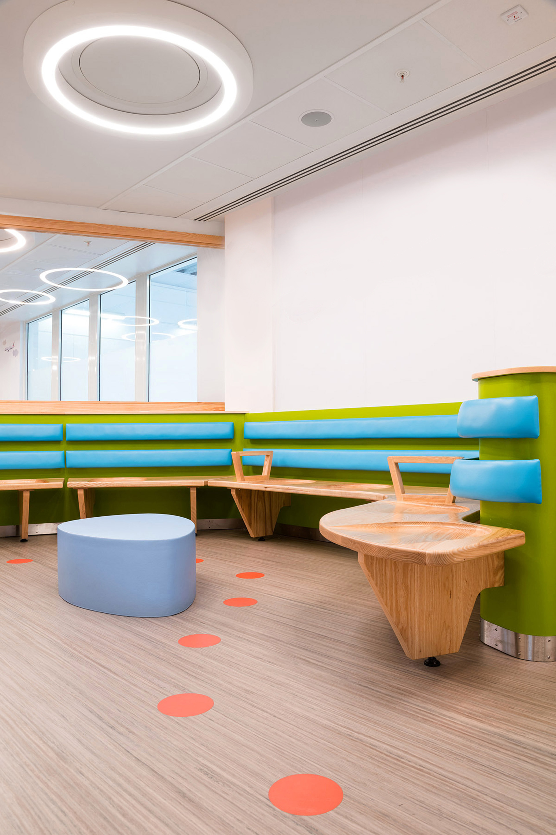 Colourful dot floor graphics provide a welcome distraction for patients waiting at Chelsea and Westminster Hospital