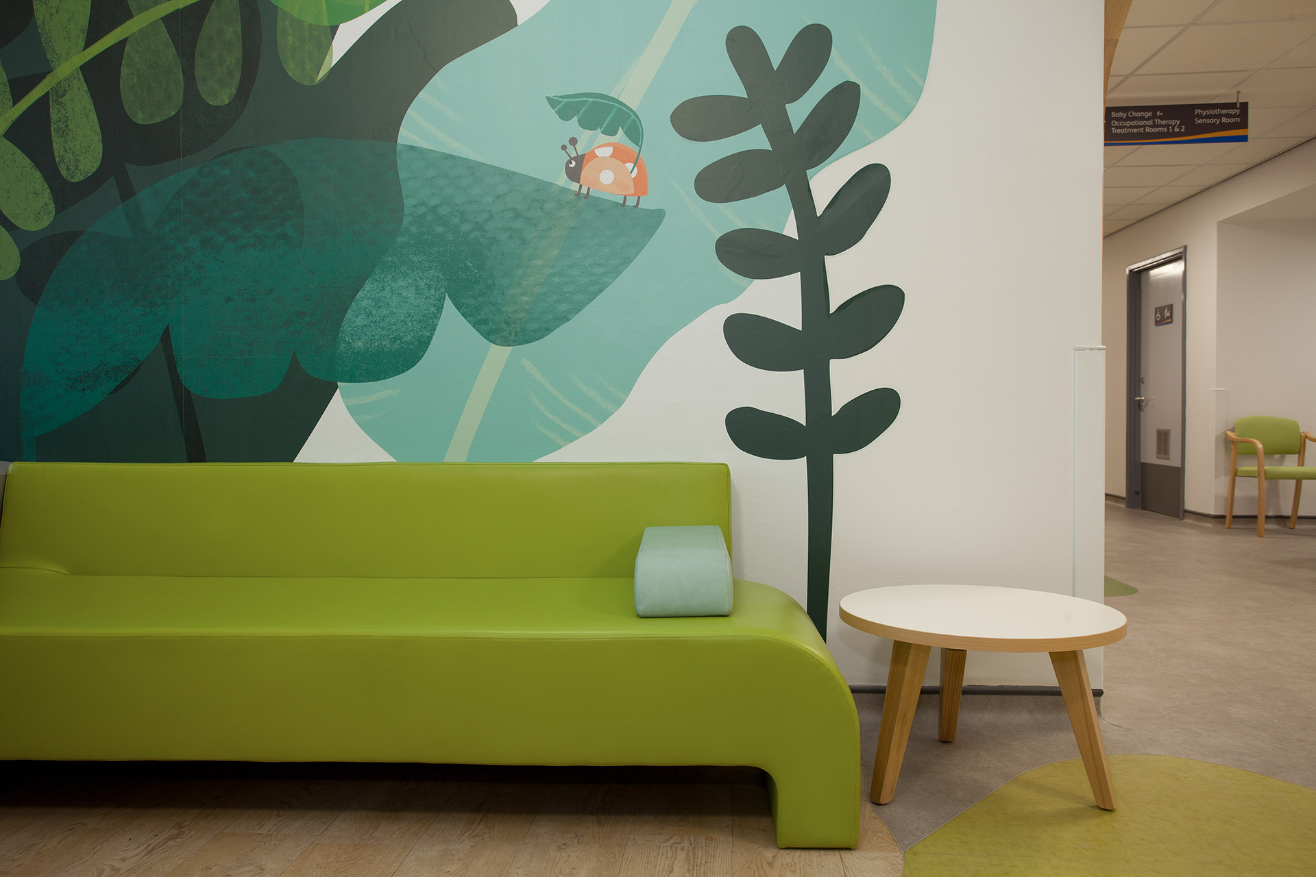 Infection safe upholstery in bright colours to compliment wall graphics