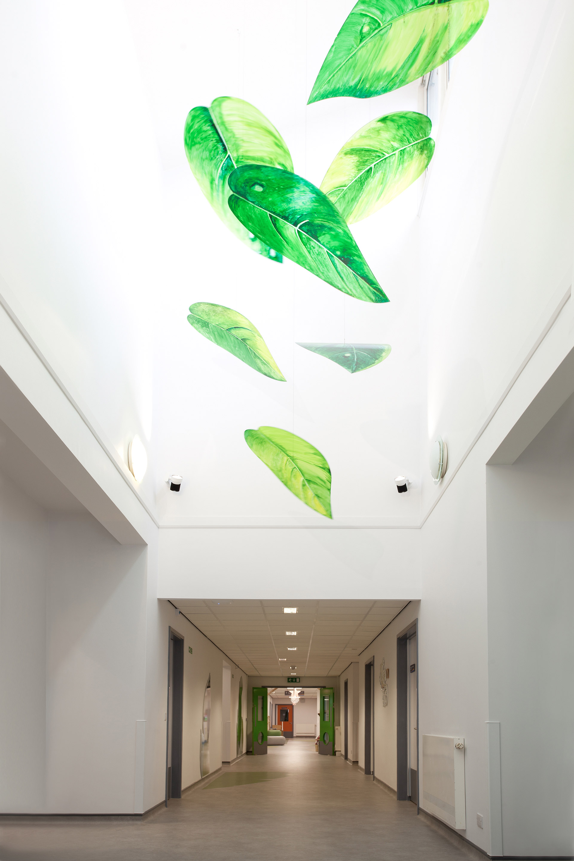 the leaf mobile designed in collaboration with Jan Blake fills the light atrium
