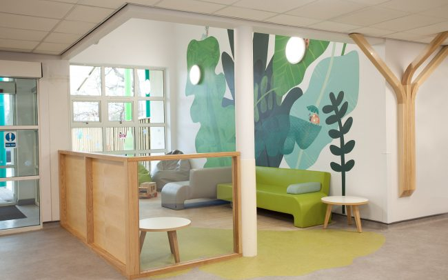 Organic shapes and natural materials help define the waiting area