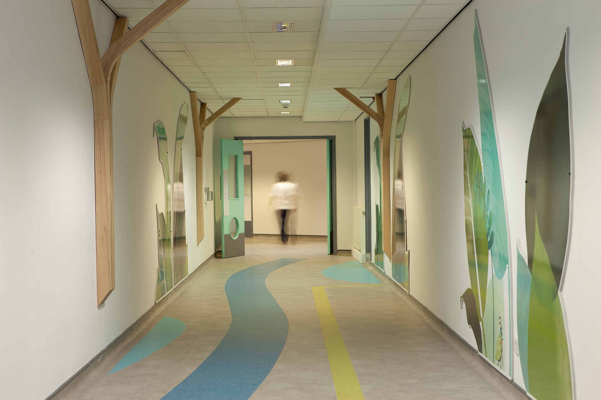 leaf inspired wall and floor graphics make corridors a more inviting space