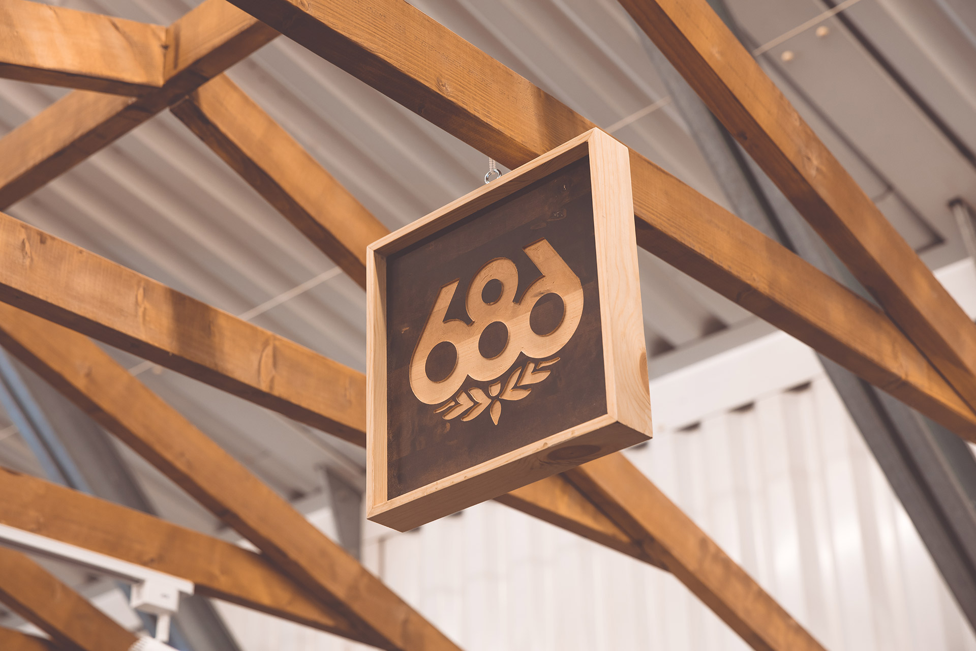 timber brand hung detail sign