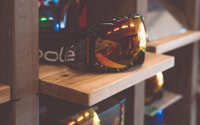 timber ski goggle display to allow extra stock to be stored below display