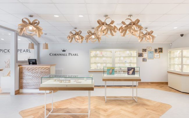 Parquet flooring detail highlights jewellery display units