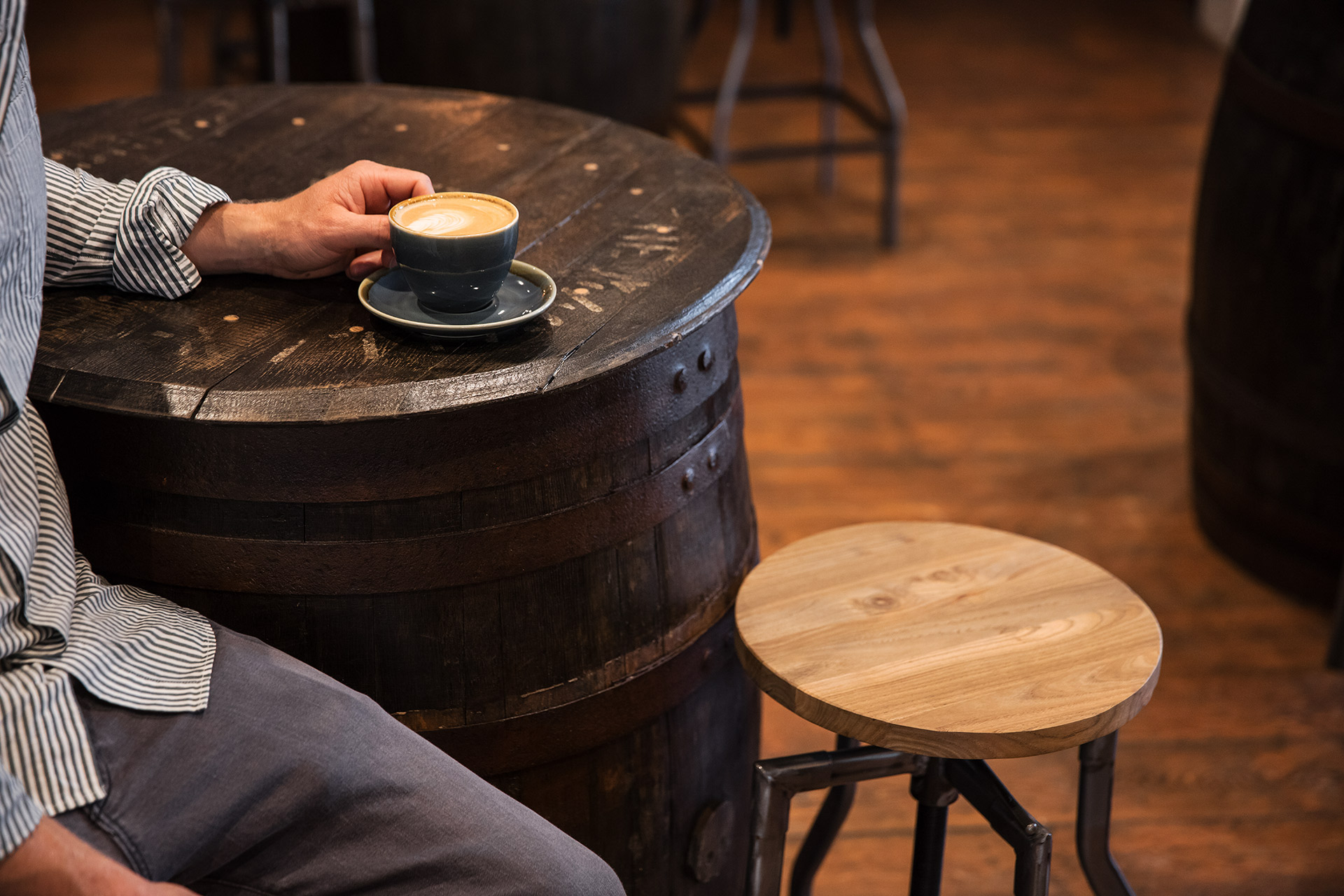 Coffee and on reclaimed barrel table in the bar