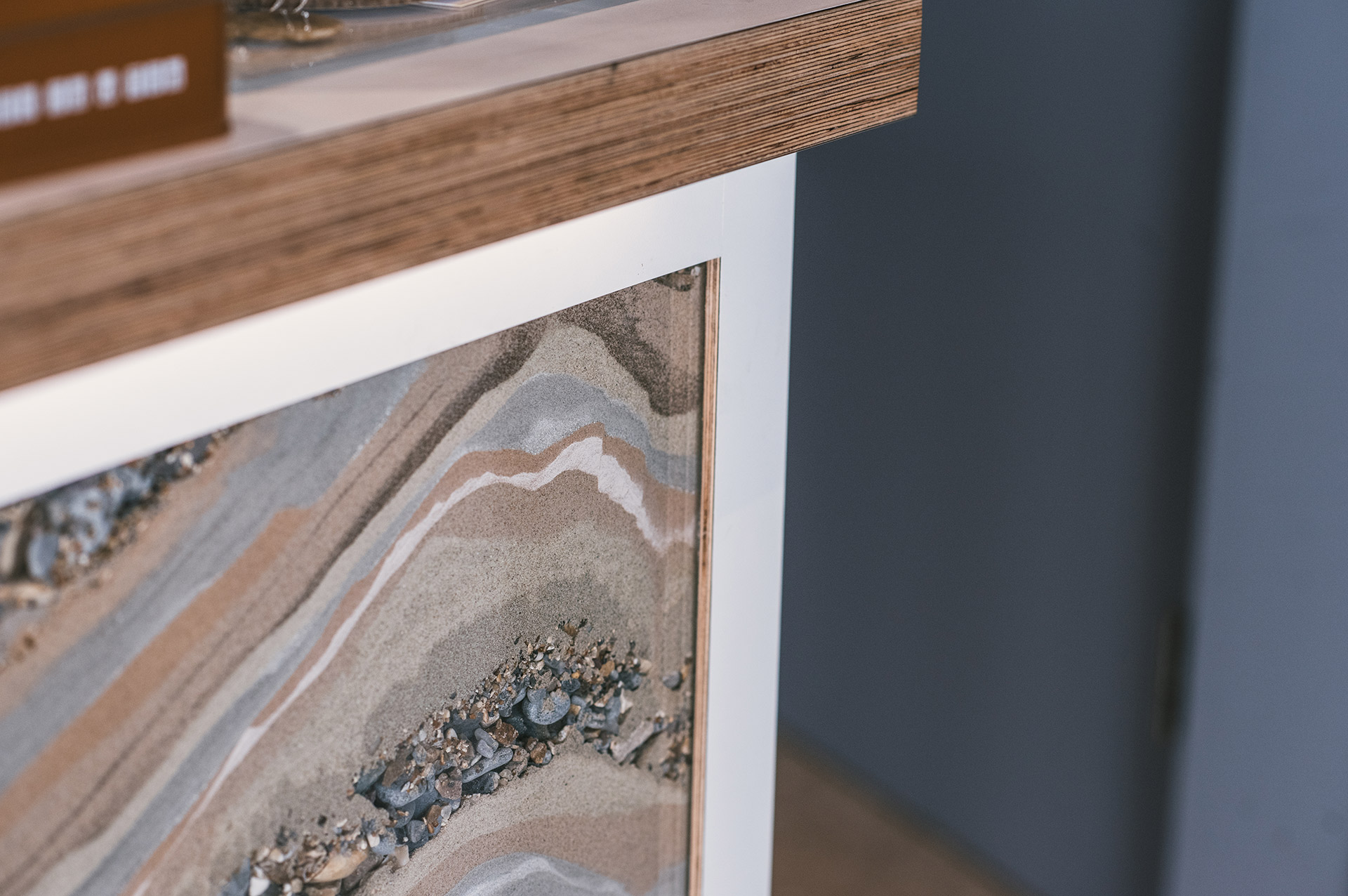 hand poured sand strata reception counter front