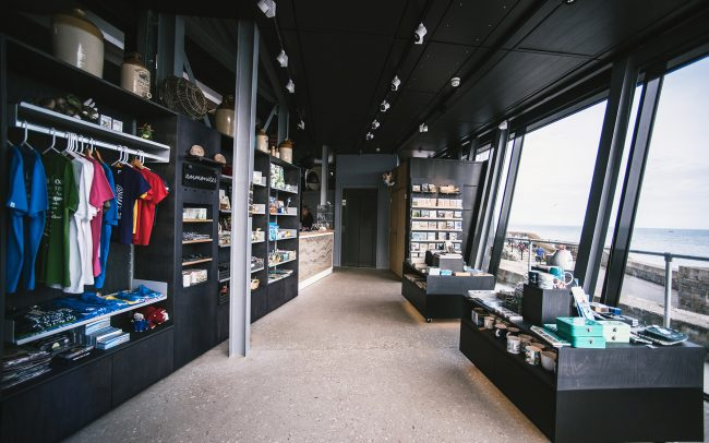 black interior referencing blue lias stone visible in cliffs dominating Lyme Regis