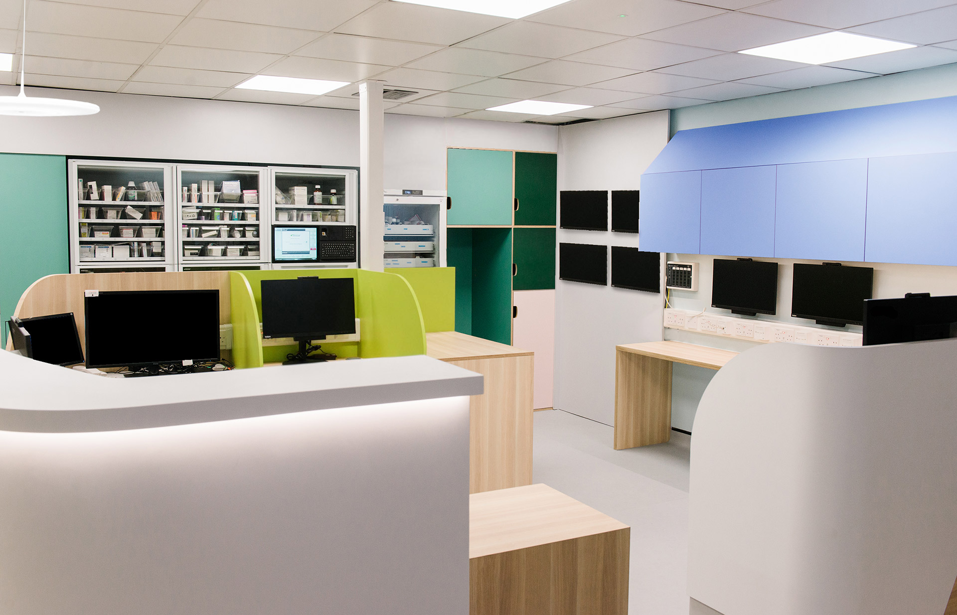 Bright coloured nurses station at NHS london hospital