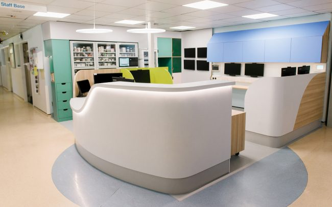 Bespoke healthcare compliant reception desk designed for London hospital