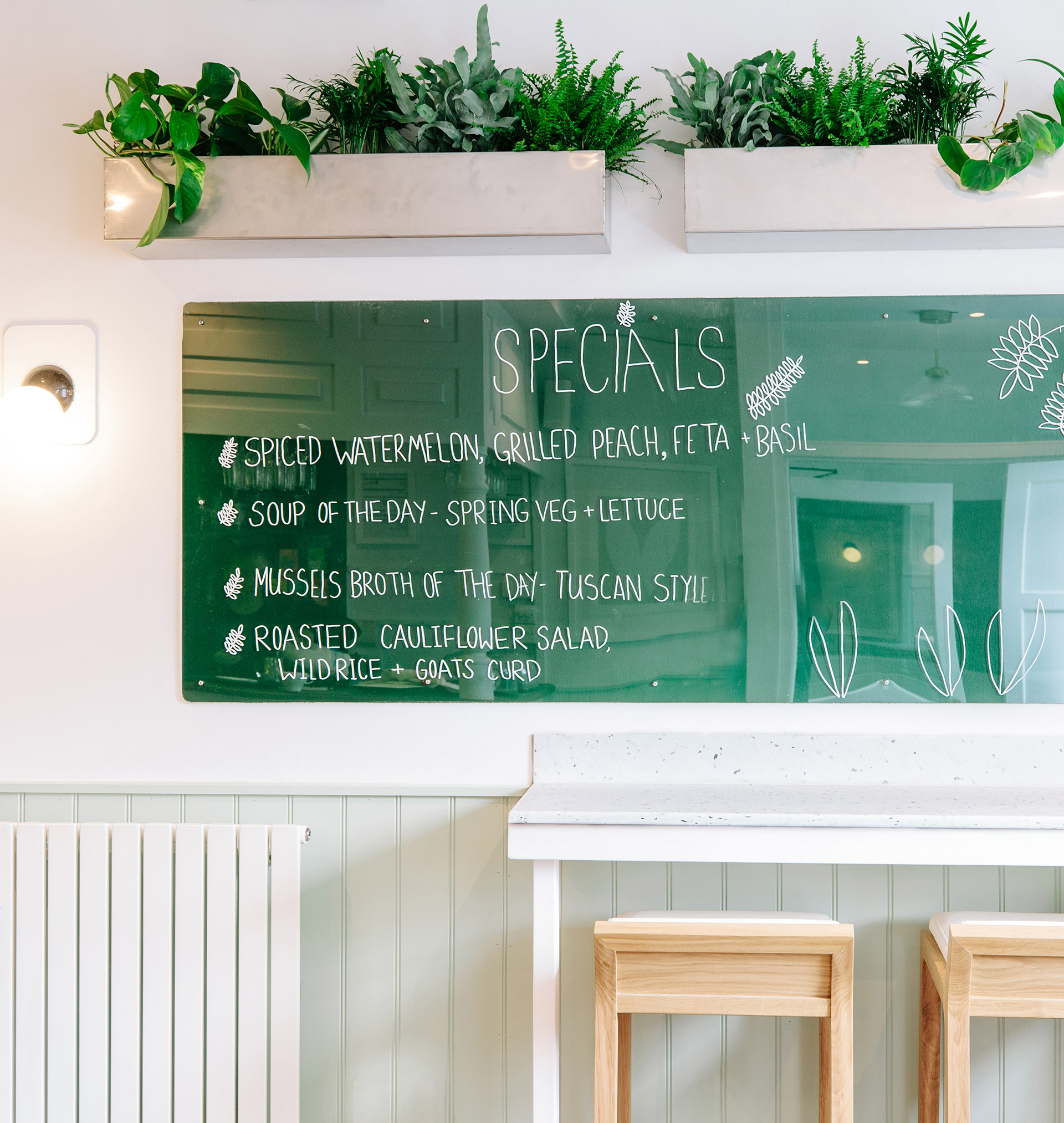 green perspex menu board and recycled plastic grab and go bar