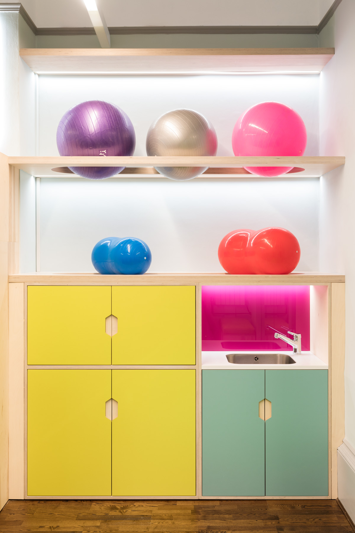 Storage in bright colours and physiotherapy swiss ball storage with built in lighting